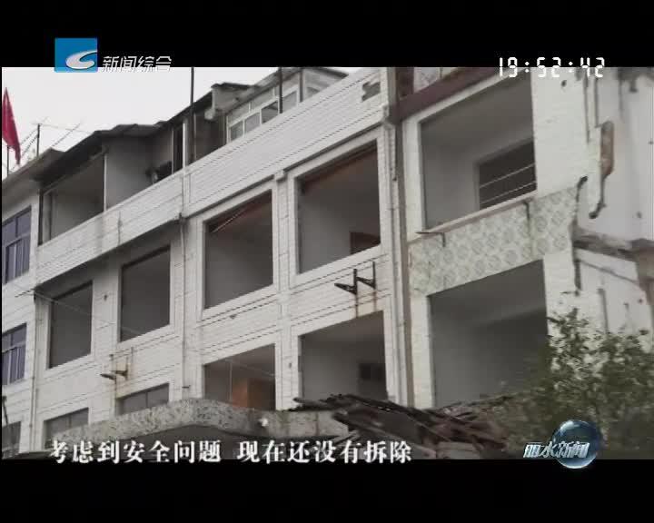 [电视问政·反馈]城东公寓项目:12户已搬离 两户未拆除